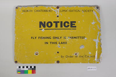 Yellow painted metal sign