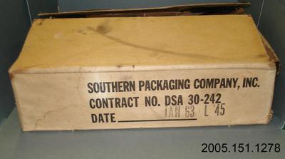 Box containing 11 packages of tinned combat meals