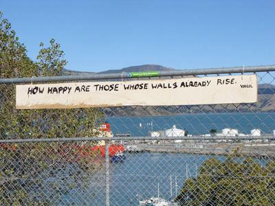 Digital Photograph: Virgil quote on sign on fence; 28 Apr 2012; 2013.17.6