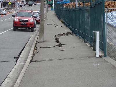 Digital Photograph: Earthquake Damage to Road on Norwich Quay, Lyttelton