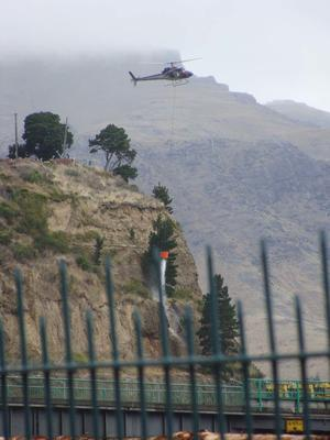 Digital Photograph: Helicopter with Monsoon Bucket washing away unstable rocks