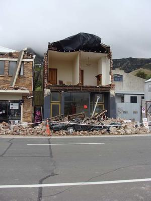 Digital Photograph: Earthquake Damage to Buildings and Car on Norwich Quay, Lyttelton
