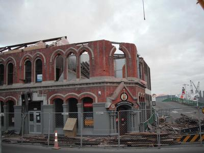 Digital Photograph: Partial demolition of the Old Lyttelton Harbour Board Offices, corner of Oxford Street and Norwich Quay, Lyttelton
