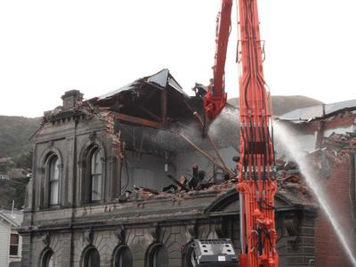 Digital Photograph: Demolition of the former Library, Council Chambers and Magistrates' Court, corner of Oxford Street and Sumner Road, Lyttelton; 11 Jun 2011; 2013.17.73