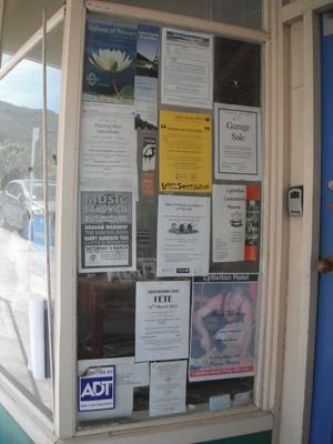 Digital Photograph: Flyers in the Window of the Lyttelton Information Centre, Oxford Street, Lyttelton