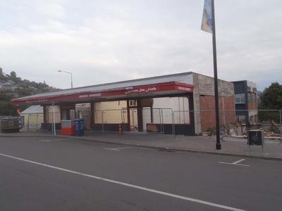 Digital Photograph: Partially Demolished Shops, corner of London and Oxford Streets, Lyttelton