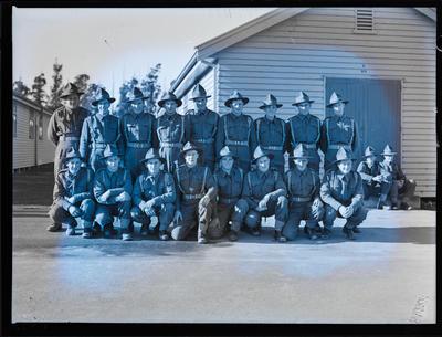 Film negative: Nineteen soldiers outside barracks