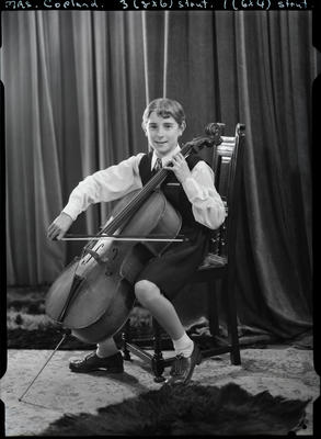 Film negative: Mrs Copland, girl with cello