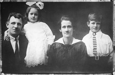 Film negative: Unidentified family group of four