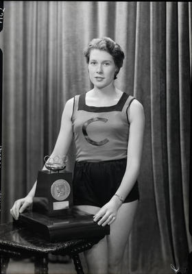 Film negative: Mr Wilson, sports woman in Canterbury tunic with Yvette Williams Olympic award