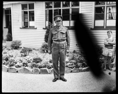 Film negative: Royal Tour, officer and small boy