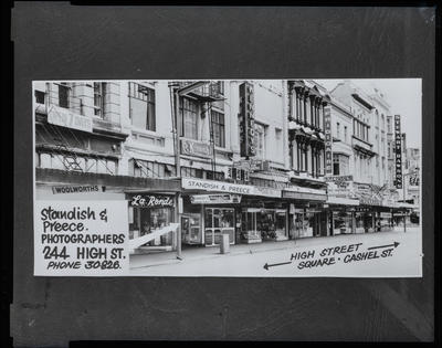 Film negative: Front of a building, and advertising material