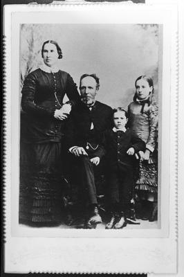 Film negative: Miss R T Robins, family group of four