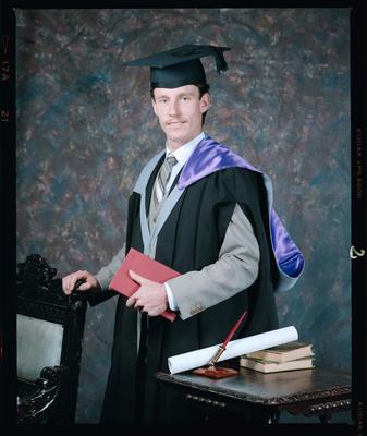 Negative: Mr Rodgers Graduate