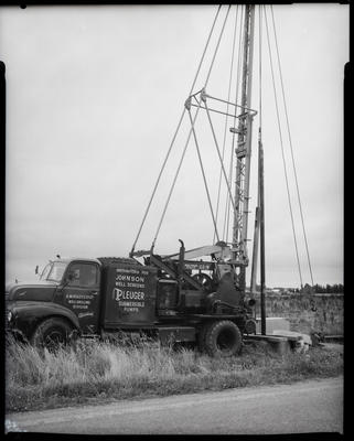 Film negative: A M Bisley and Company, well drilling rig