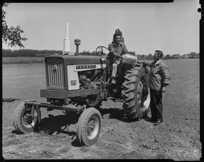 Film negative: International Harvester Company: handing over a prize