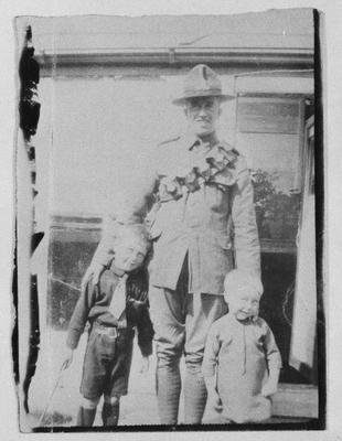 Film negative: Mr C Robinson, soldier and two children