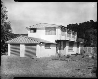 Film negative: Two-storey house with aluminium window frames