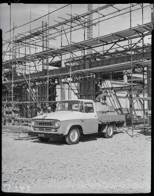 Film negative: International Harvester Company: c1100 flat-deck truck, on building site