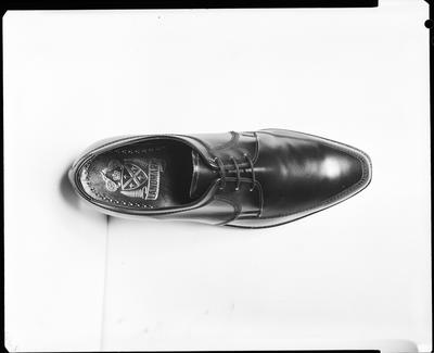 Film negative: Suckling's Shoes, man's shoe