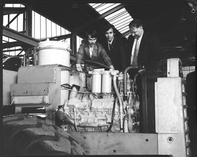 Film negative: International Harvester Company: Columbo Plan service student, looking at Hough engine