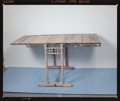 Negative: Wooden Convertible Shelf and Table