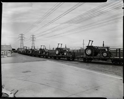 Film negative: International Harvester Company: tractors on rail wagons