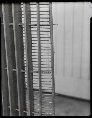 Film negative: International Harvester Company: damaged part, corcave