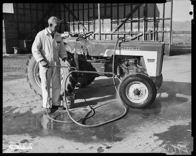Film negative: Steam cleaning wheeled tractor