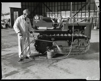 Film negative: Steam cleaning crawler tractor