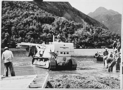 Film negative: International Harvester Company: bull dozer in river