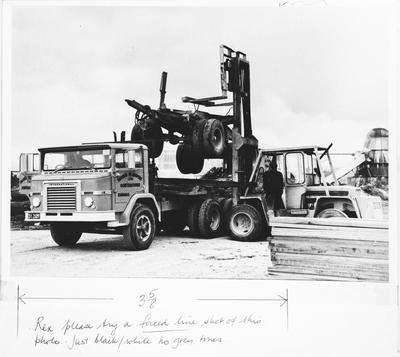 Film negative: International Harvester Company: loading trailer onto logging truck chassis