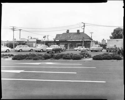 Film negative: Linwood Avenue house with lots of cars