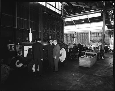 Film negative: International Harvester Company: men talking at tractor assembly
