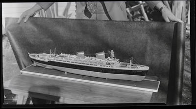 Film negative: International Harvester Company: Mr Brookhall and model of ship