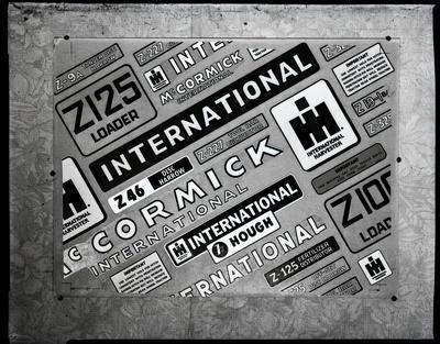 Film negative: International Harvester Company: wall of logos