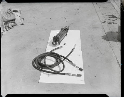 Film negative: International Harvester Company: hydraulic ram and hose