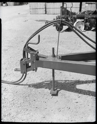 Film negative: International Harvester Company: metal frame and hoses