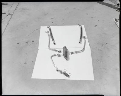 Film negative: International Harvester Company: valves and hoses, tractor bucket
