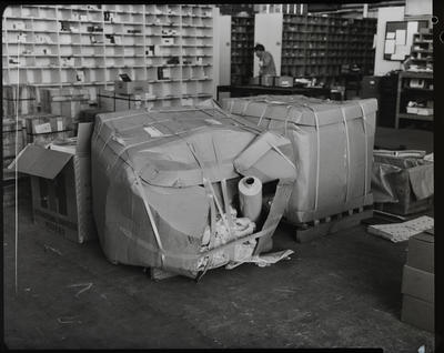 Film negative: International Harvester Company: bad package of mufflers