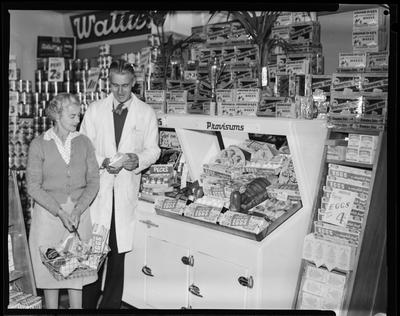Film negative: CCD Poultry Supplies, customers at display