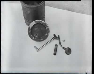 Film negative: International Harvester Company: damaged parts, housing tractor, brake drum, piston and valves