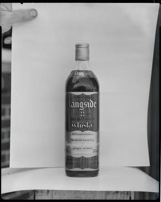 Film negative: Christchurch Working Men's Club, Langside Whisky bottle