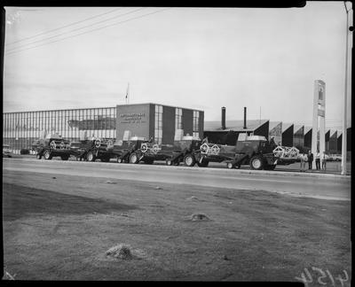 Film negative: International Harvester Company: combines outside building