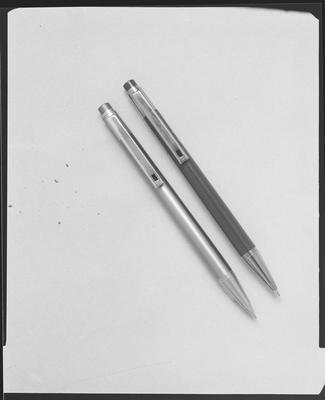 Film negative: Whitcoulls, two biro pens