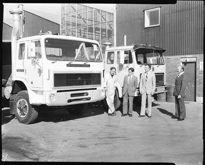 Film negative: International Harvester Company: newsletter photos, truck and four men