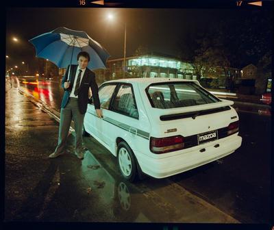 Negative: Amuri Motors Man With Umbrella