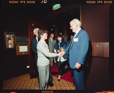 Negative: Airways Corp Man and Woman Shaking Hands