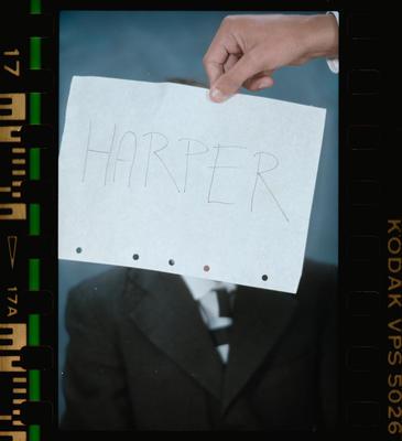 Negative: Hand Holding Sign Harper House