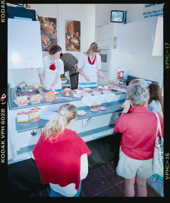 Negative: Electricorp Women Serving Food